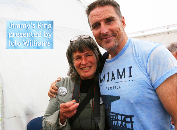 image of Gail receiving Jimmy's ring from Iolo Williams